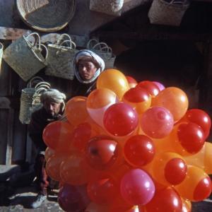 The restored slide of the man holding the ballons.